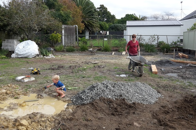 Joel's mum Sandra Payne (and master Nicolas) helping to construct the evapotranspiration (ETS) beds.