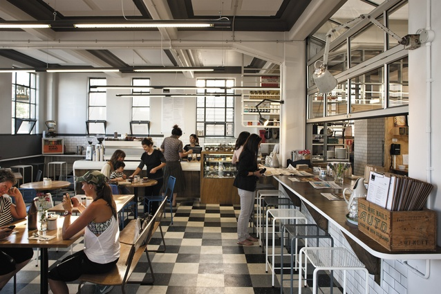interior view of kokako caf and coffee roastery floor tile colouring is repeated in - Concrete Cafe Interior