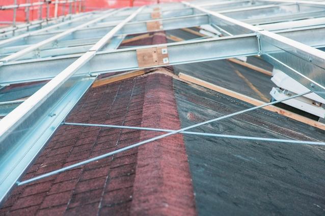 The old roof is used as temporary waterproofing during the project, with the new roof attached to the old one.