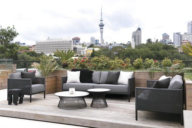 The apartment has expansive city views. The outdoor furniture is from Design Warehouse.
