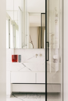 Marble finishes in the bathroom create high-end appeal.