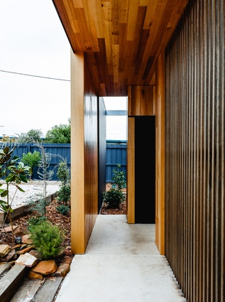 The colour scheme of black and timber carries through the whole house.
