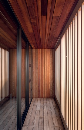 The first-floor balcony is lined with cedar panelling and plantation-grown hardwood decking.