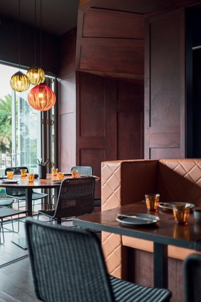 Upstairs is a quieter space, intended for longer meals, with lower seats and tables and subtle colours.