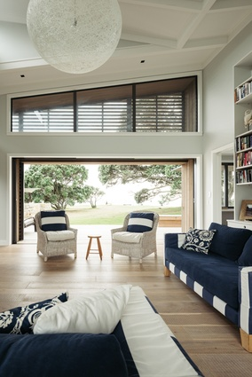 Screens on the upper-level windows provide  filtered light in the sitting room.