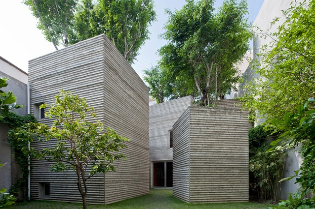 House for Trees in Ho Chi Minh City, Vietnam, replicates a bundle of pot plants with trees growing on top.