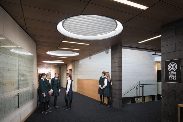Louvred circular skylights draw sunlight into the corridors.
