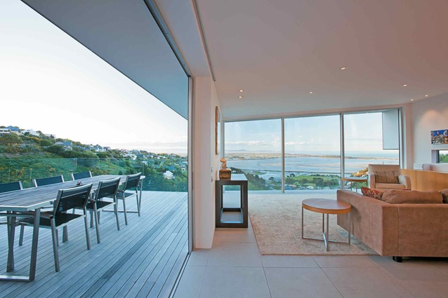 The floor-to-ceiling glazing in the living area looks out to views of the estuary.