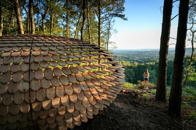 Perspectives by designer Giles Miller, Surrey, England. This shingle-covered structure is inscribed with various personal messages and is sited at the top of a natural vista.