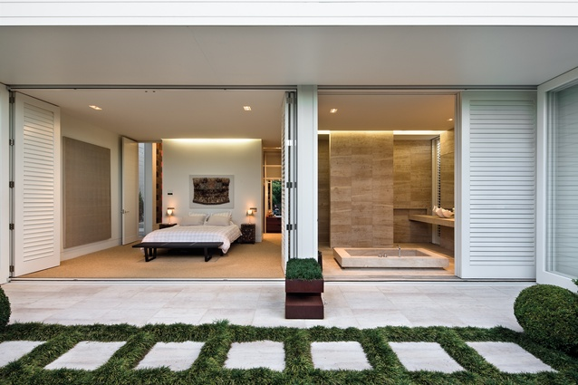 More Grown-up House: The bedroom and en suite open directly onto the courtyard.
